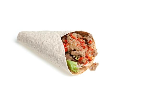 Аппетитный фастфуд, донер, бутерброд с кебабом, шаурма с мясом и овощами.