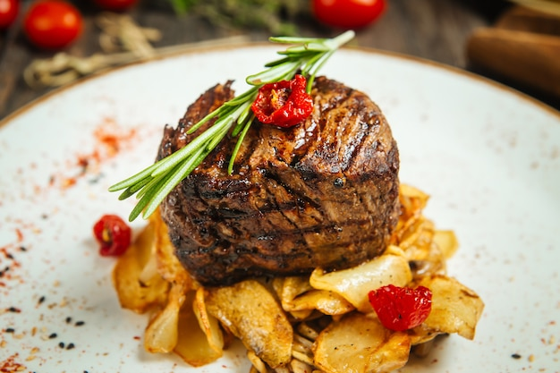 Appetizing filet mignon steak with potato chips