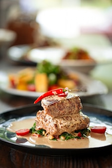 Appetizing fillet mignon steaks with sauce