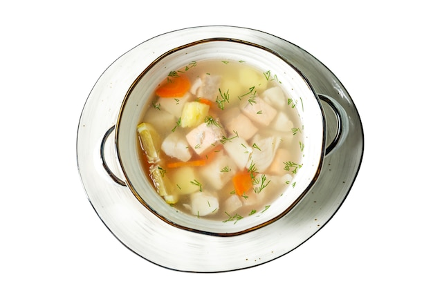 Appetizing fish soup with lemon in a plate