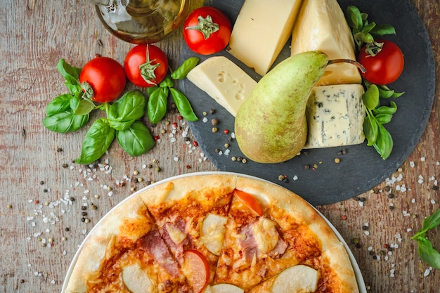 Appetizing hawaiian pizza with a pear