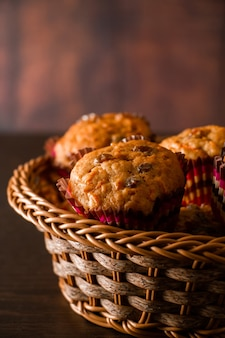 Appetizing homemade muffins on a wooden cutting board. traditional festive christmas baking.