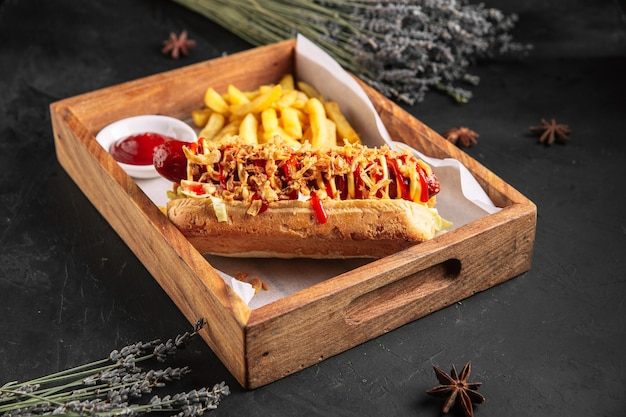 Appetizing hot dog with onion shavings and fries