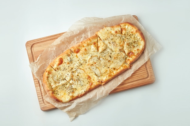 Appetizing italian pizza 4 cheese with pear on a wooden tray on a gray table. top view. italian cuisine