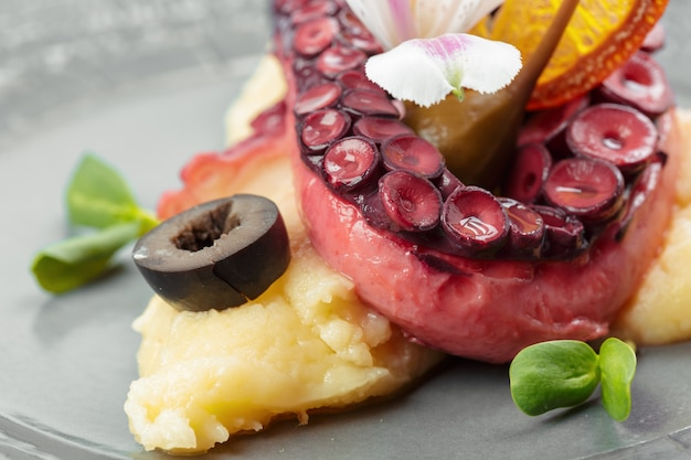 Appetizing octopus with baked potatoes