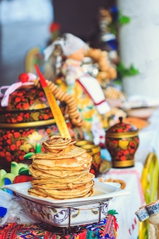 Appetizing pancakes for guests on the table at shrovetide