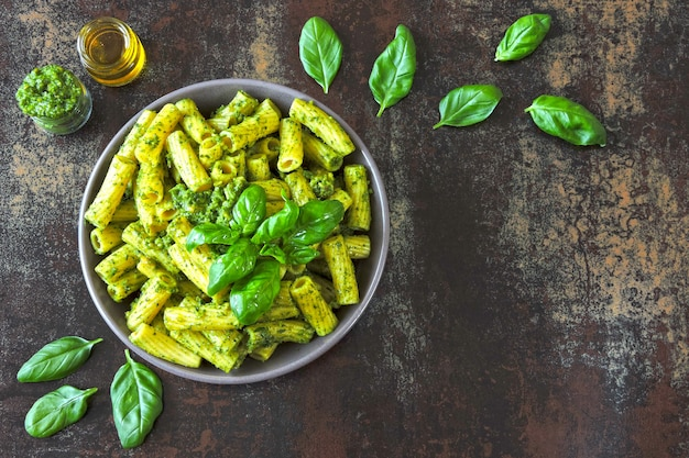 Appetizing pasta with pesto and basil