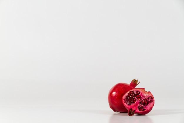 Appetizing pomegranates on white background