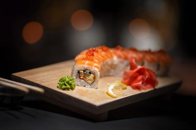 Appetizing rolls lie on a wooden plate.