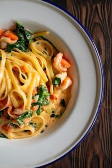 Appetizing shrimp pasta noodles with creamy sauce