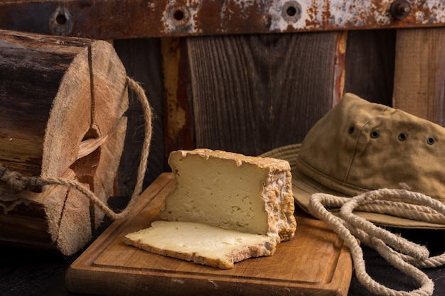Appetizing slices of farm craft cheese on boards
