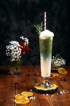 Appetizing sweet cool green milkshake cocktail