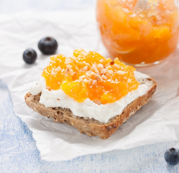 Appetizing whole toast with cream cheese and jam