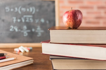 Apple and books in classroom