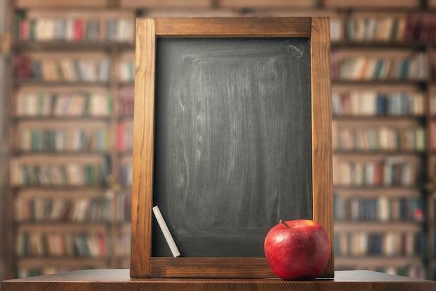 Apple, chalkboard and chalk. back to school