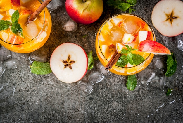 Apple cider mojito cocktails with mint, cinnamon and ice