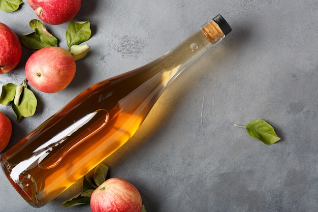 Apple cider vinegar and fresh apples, space for your text