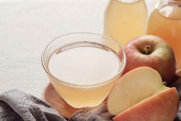 Apple cider vinegar with mother in glass bowl