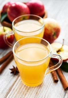 Apple cider  with cinnamon sticks