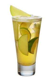 Apple cocktail with beer, lime and ice cubes in highball glass isolated on white