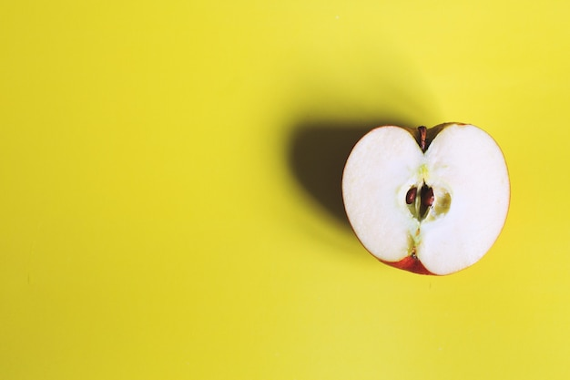 Apple cut on a yellow background