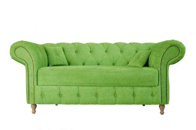 白い背景に分離された木製の足にアップルグリーンのソファ