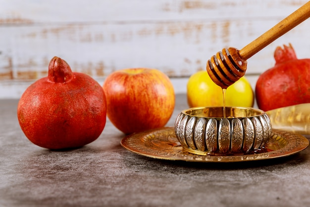 Apple and honey, kosher traditional food of jewish new year rosh hashana shofar