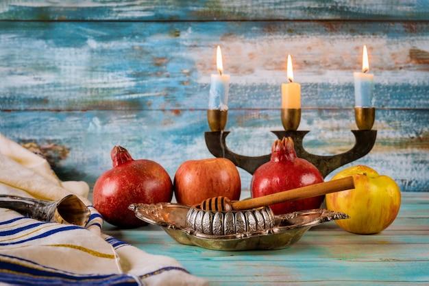 Apple and honey, kosher traditional food of jewish new year rosh hashana talit and shofar