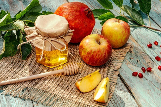 Apple and honey and pomegranate, traditional food of jewish new year