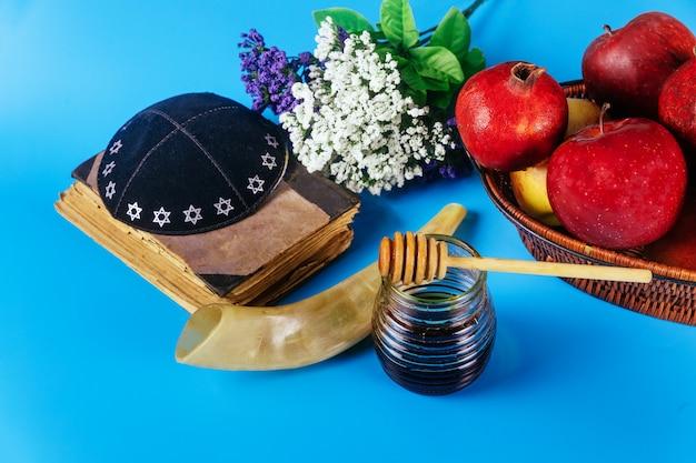 Apple and honey, traditional food of jewish new year rosh hashana torah book, kippah yamolka