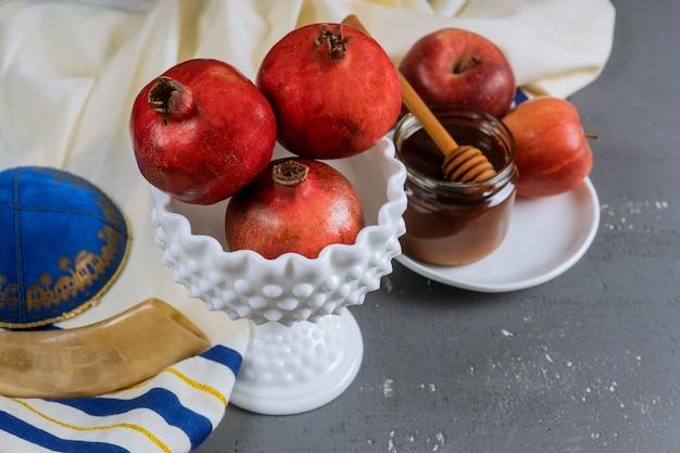 Apple and honey, traditional food of jewish new year rosh hashana torah book