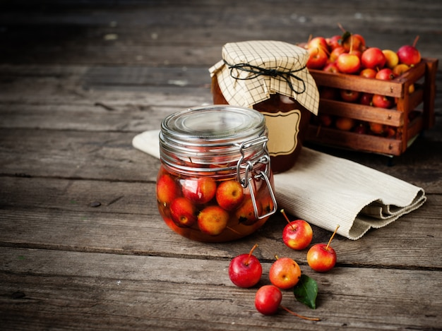 Apple jam in jar and apple fruits. autumn still life.
