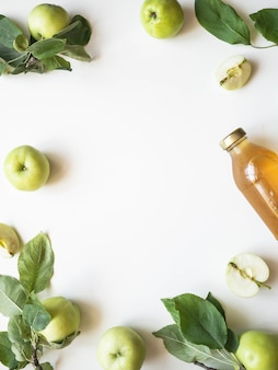 Apple juice and fresh apples and leaves on a white background. flat lay. top view. copy space
