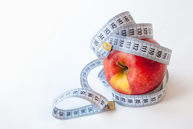 Apple and measuring tape. diet concept