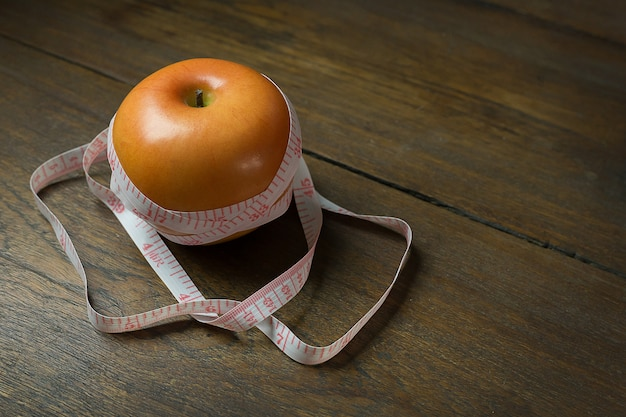 Apple & measuring tape image  for diet content.