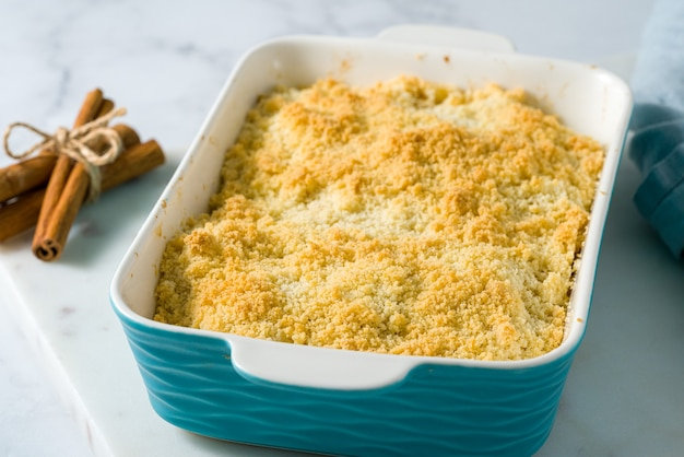 Apple and pear crumble pie. side view close up