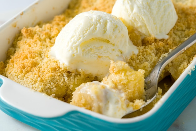Apple and pear crumble with ice cream. close up