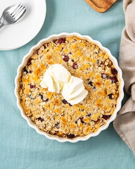Apple and pear crumble with ice cream streusel sweet dessert with oats