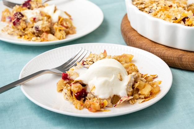 Apple and pear crumble with ice cream streusel sweet dessert with stewed fruit topped