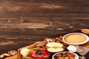 Apple pie ingrediens over brown wooden
