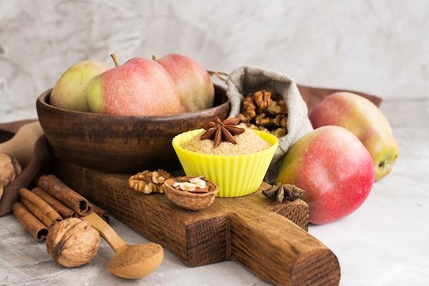 Apple pie ingredients over stone table