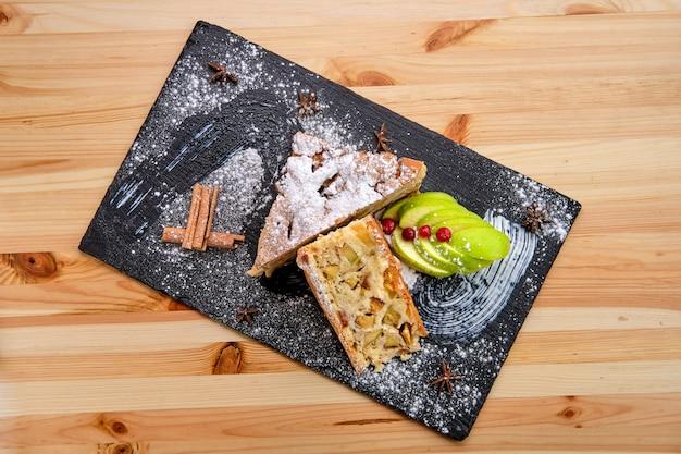 Apple pie on slate plate top view