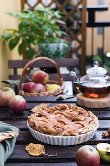 Apple pie and teapot with black tea, thanksgiving