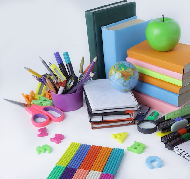 Apple, plasticine and school supplies isolated on white background