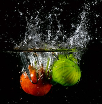 Apple and prickly pear splash in water