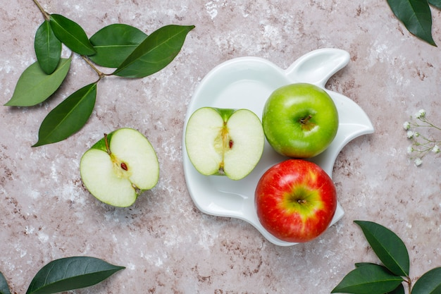 Apple puff pastry cookies in apple shape plate with fresh apples