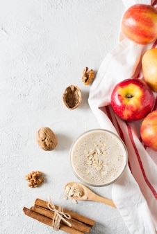 Apple qatmeal smoothie raw helthy breakfast over white background