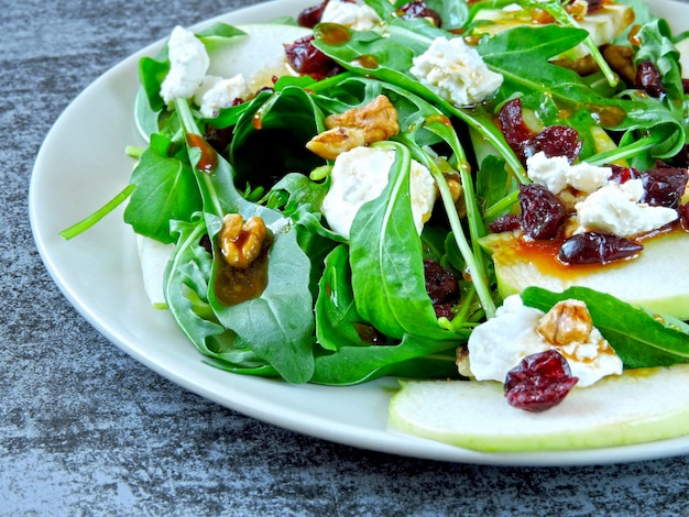 Apple salad with arugula, cottage cheese and dried cranberries