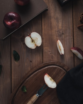 Apple slices on wooden table, top view