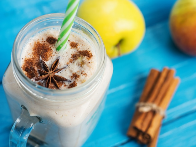 Apple smoothie in a glass with cinnamon